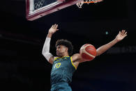 Australia's Matisse Thybulle (10) hangs in the air as he scores against against Italy during a men's basketball preliminary round game at the 2020 Summer Olympics, Wednesday, July 28, 2021, in Saitama, Japan. (AP Photo/Eric Gay)