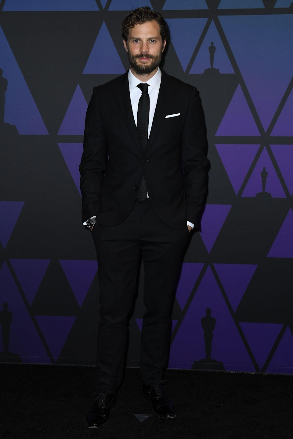 <p>The <em>Fifty Shades</em> star wore a navy suit and tie at the 10th annual Governors Awards at the Ray Dolby Ballroom in Los Angeles. <em>[Photo: Getty]</em> </p>