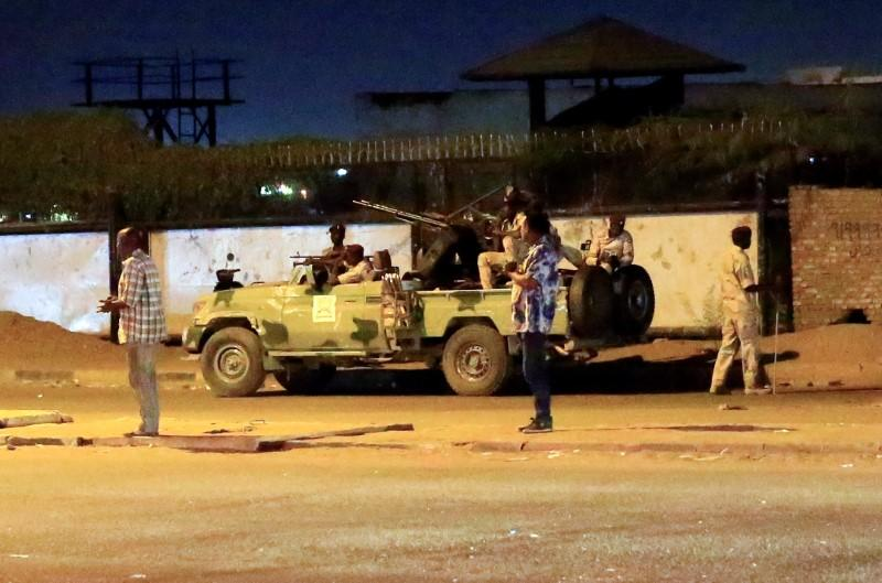 Members of Sudanese Rapid Support Forces are seen near the area where gunmen opened fire in Khartoum