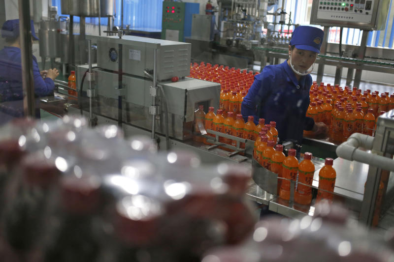 In this Oct. 22, 2018, photo, a worker monitors the production of bottled beverage at Songdowon General Foodstuffs Factory in Wonsan, North Korea. Though the international spotlight has been on his denuclearization talks with Washington, the North Korean leader has a lot riding domestically on his promises to boost the country's economy and standard of living. His announcement in April that North Korea had sufficiently developed its nuclear weapons and would now focus on building its economy marked a sharp turn in official policy and set the stage for his rapid-fire meetings with the leaders of China, South Korea and the United States. (AP Photo/Dita Alangkara)