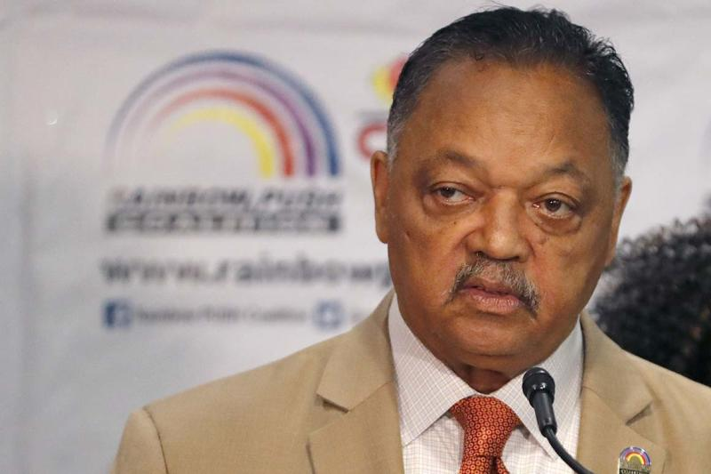 Rev. Jesse Jackson addresses reporters at the start of the Rainbow PUSH Coalition Annual International Convention Friday, June 28, 2019, in Chicago. Former vice president Joe Biden will be the first presidential candidate to addresses the five-day convention. (AP Photo/Charles Rex Arbogast)
