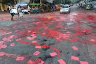 Yangon protesters splashed crimson paint across the streets