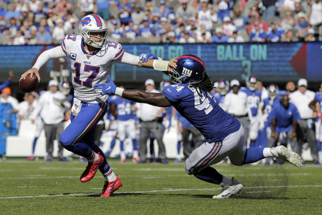 Buffalo Bills quarterback Josh Allen, left, evades New York Giants' Markus Golden during the second half of an NFL football game, Sunday, Sept. 15, 2019, in East Rutherford, N.J. (AP Photo/Adam Hunger)