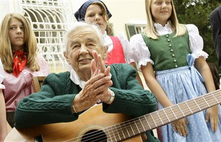File photo of Maria von Trapp makes sitting with children in front of her former home Villa Trapp in Salzburg