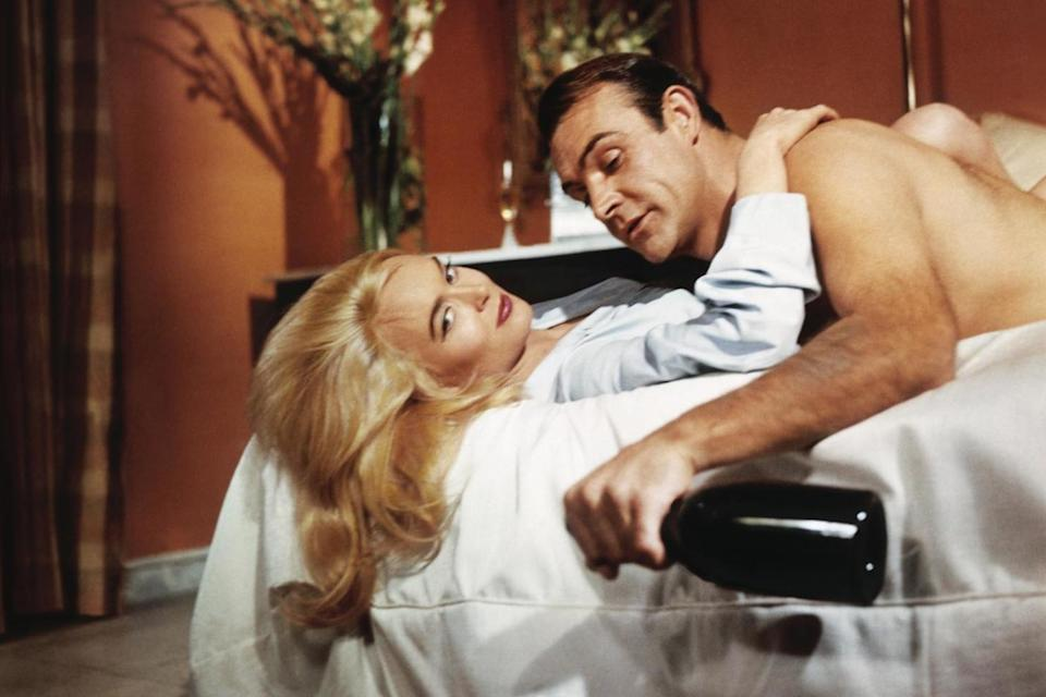 Irresistible: James Bond (Sean Connery) beds Jill Masterson (Shirley Eaton) in Goldfinger, 1964: Sportsphoto Ltd./Allstar