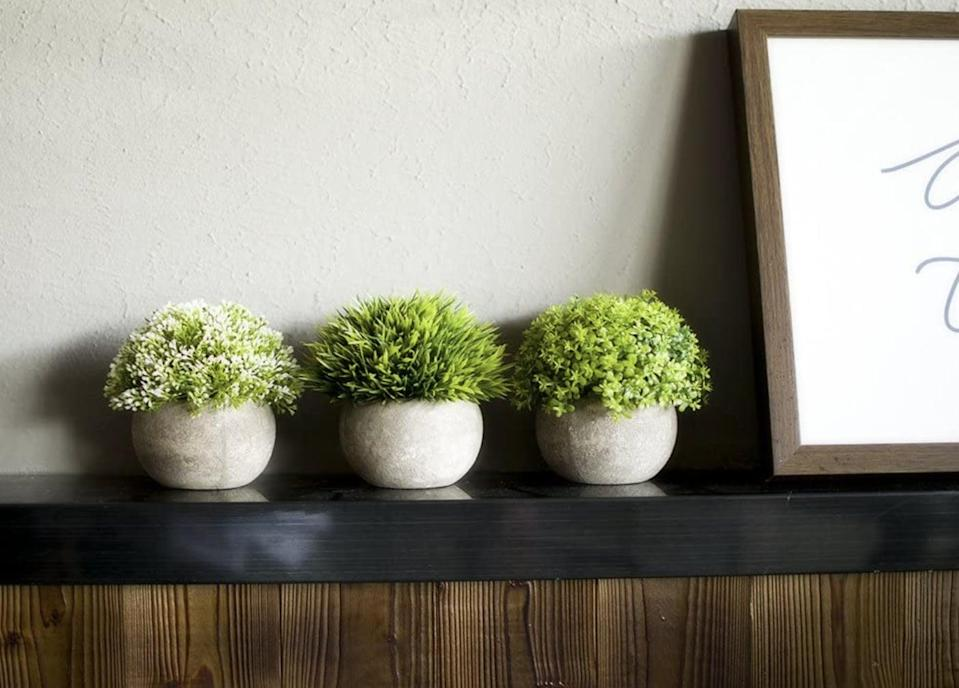 <p>Place the <span>Opps Mini Artificial Plants</span> ($25) around your home to feel like you've transformed your space into a garden oasis.</p>