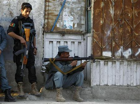 Afghan policemen take position at the site of an attack in Kabul