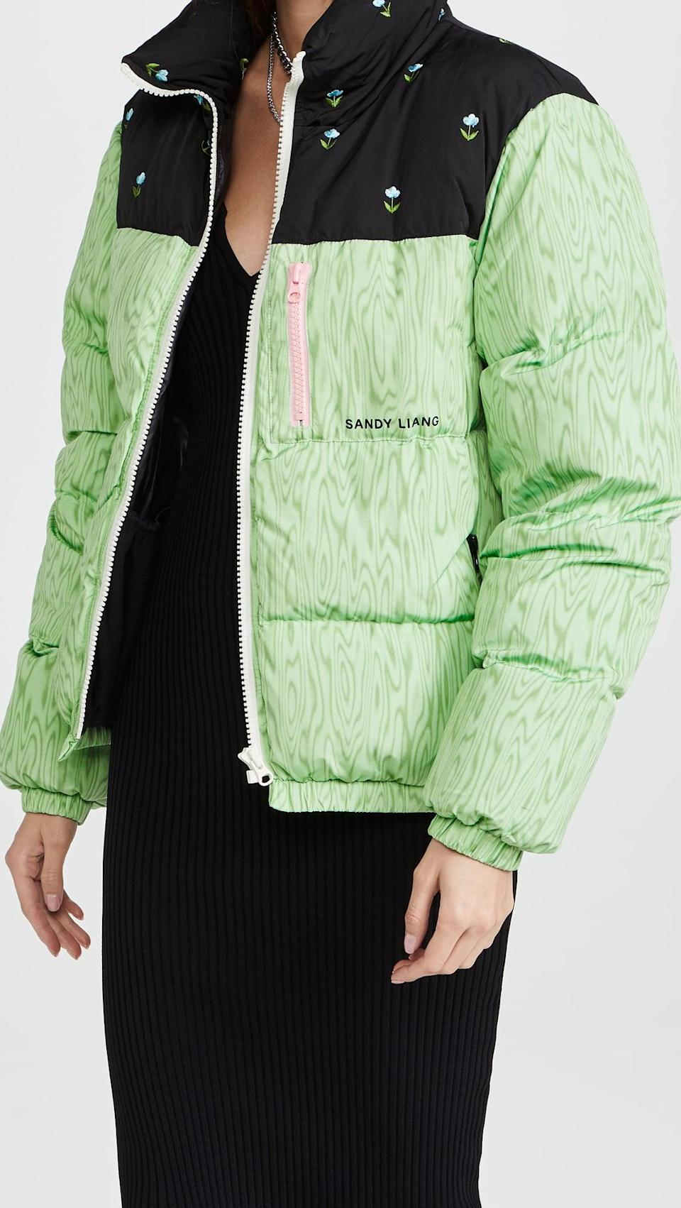 <p>This <span>Sandy Liang Jeffrey Puffer Jacket</span> ($890) is a little bit whimiscal, which we love. The pink zipper against the green print is so fun, and we love the little floral details too.</p>