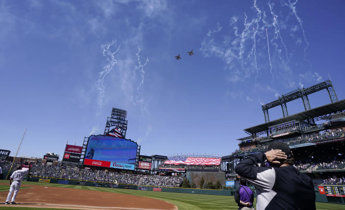Two F-16 jets from Buckley Air Force Base in Aurora, Colo., fly over Coors Field before a baseball game between the Los Angeles Dodgers and the Colorado Rockies on opening day, Thursday, April 1, 2021, in Denver. The Rockies won 8-5. (AP Photo/David Zalubowski)