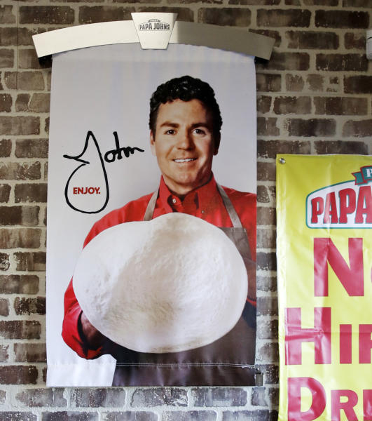 <p> FILE- In this Dec. 21, 2017, file photo shows signs, including one featuring Papa John's founder John Schnatter, at a Papa John's pizza store in Quincy, Mass. Papa John's plans to pull Schnatter's image from marketing materials after reports he used a racial slur. Schnatter apologized Wednesday, July 11, 2018, and said he would resign as chairman after Forbes reported that he used the slur during a media training session. Schnatter had stepped down as CEO last year after criticizing NFL protests. (AP Photo/Charles Krupa, File) </p>