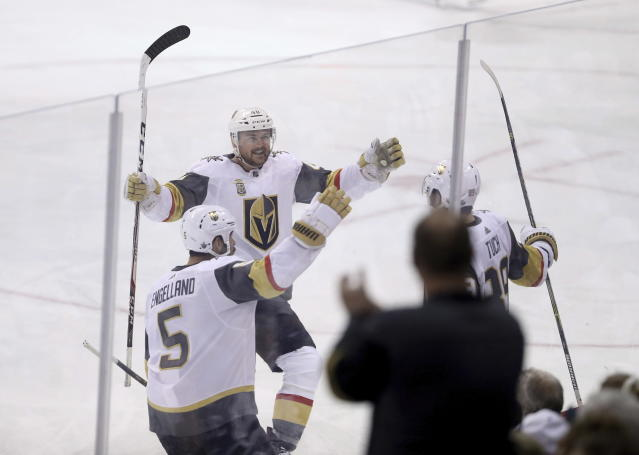 Vegas Golden Knights' Deryk Engelland (5), Ryan Carpenter (40) and Alex Tuch (89) celebrate after Tuck scored during first period NHL Western Conference Finals game 5 hockey action against the Winnipeg Jets, in Winnipeg, Sunday, May 20, 2018. (Trevor Hagan/The Canadian Press via AP)