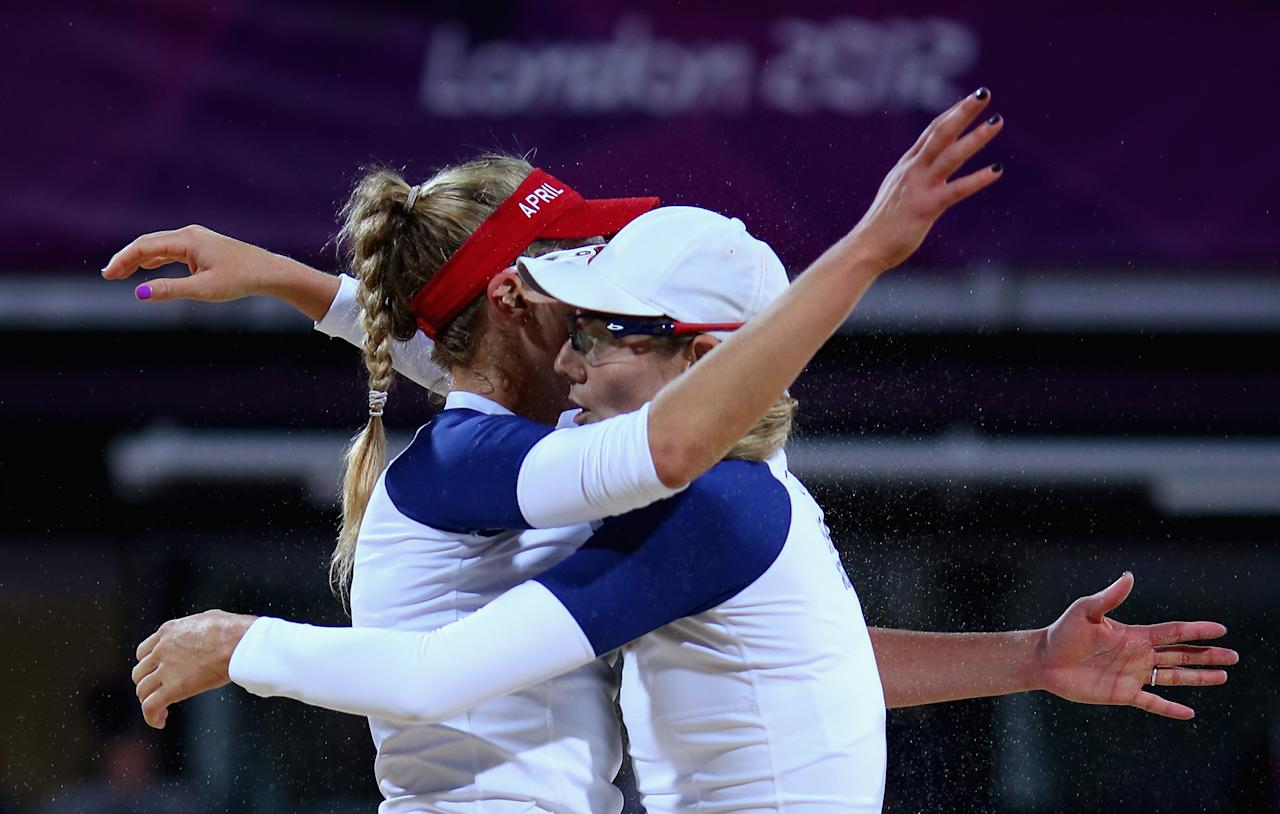 April Ross of the United States and Jennifer Kessy of the United States celebrate during the Women's Beach Volleyball Quarter Final match between United States and Czech Republic on Day 9 of the London 2012 Olympic Games at Horse Guards Parade on August 5, 2012 in London, England.  (Photo by Ryan Pierse/Getty Images)