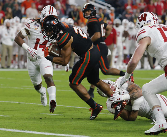 "<a class=""link rapid-noclick-resp"" href=""/ncaaf/players/267318/"" data-ylk=""slk:Travis Homer"">Travis Homer</a> was Miami""s leading rusher after Mark Walton was injured. (AP Photo/Joe Skipper)"