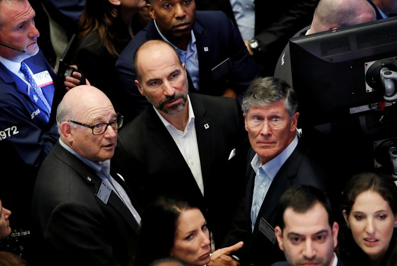 Uber Technologies Inc. CEO Dara Khosrowshahi, (C) Chairman Ronald Sugar (L) and Board Member John Thain (R) stand together on the trading floor of the New York Stock Exchange (NYSE) during the company's IPO in New York, U.S., May 10, 2019. REUTERS/Andrew Kelly TPX IMAGES OF THE DAY