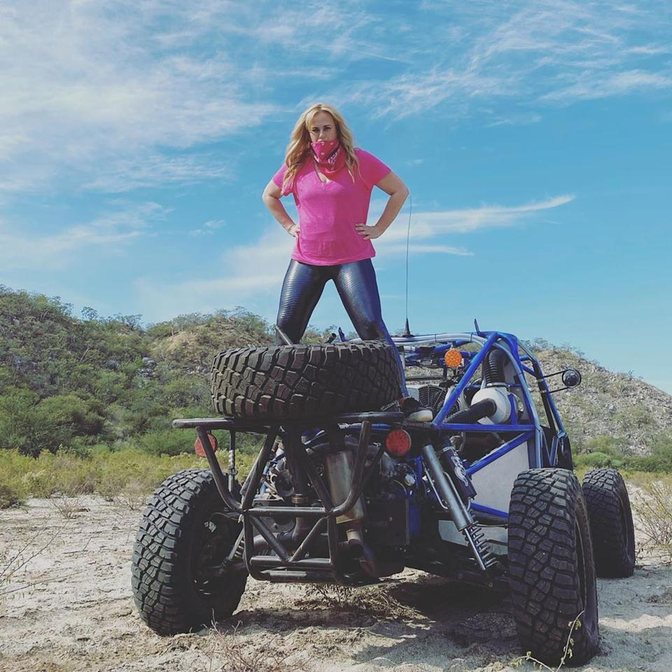 Rebel Wilson standing on a sand buggy
