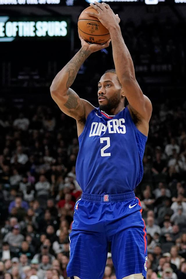 Los Angeles Clippers' Kawhi Leonard shoots during the first half of an NBA basketball game against the San Antonio Spurs, Saturday, Dec. 21, 2019, in San Antonio. (AP Photo/Darren Abate)
