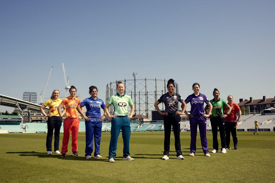 The Hundred captains gather on the outfield (PA Media)