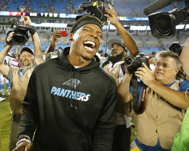 FILE - In this Aug. 9, 2017, file photo, Carolina Panthers quarterback Cam Newton laughs after the second half of an NFL preseason football game against the Houston Texans, in Charlotte, N.C. Cam Newton is a former league MVP and the long-time face of the Panthers franchise. But it's hard not to wonder if his future in Carolina is coming to an end following his recent spate of injuries. (AP Photo/Jason E. Miczek, File)