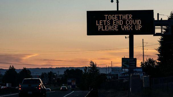 PHOTO: A digital highway sign promotes COVID-19 vaccination on May 14, 2021 in Vancouver, Wash. (Nathan Howard/Getty Images, FILE)
