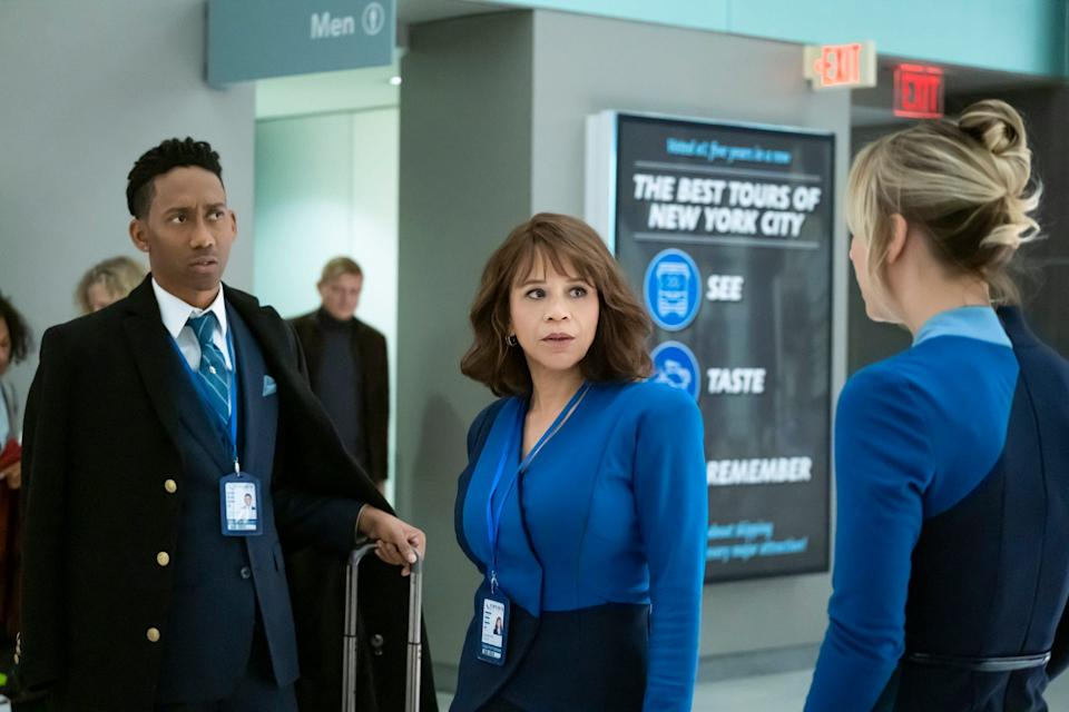 """Cassie Bowden (Kaley Cuoco), right, talks to colleagues Shane (Griffin Matthews), left, and Megan (Rosie Perez) in HBO Max's """"The Flight Attendant."""""""