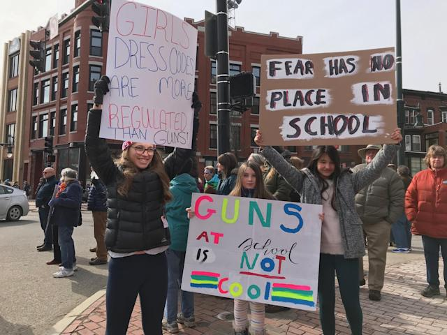 Several girls hold up protest signs at the March for Our Lives in Portland, Maine, on March 24, 2018. (Photo: Courtesy of Christina Neuner)