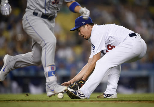 Los Angeles Dodgers pitcher Kenta Maeda, right, fields an infield ground ball hit by New York Mets' Michael Conforto during the eighth inning of a baseball game in Los Angeles, Monday, Sept. 3, 2018. (AP Photo/Kelvin Kuo)