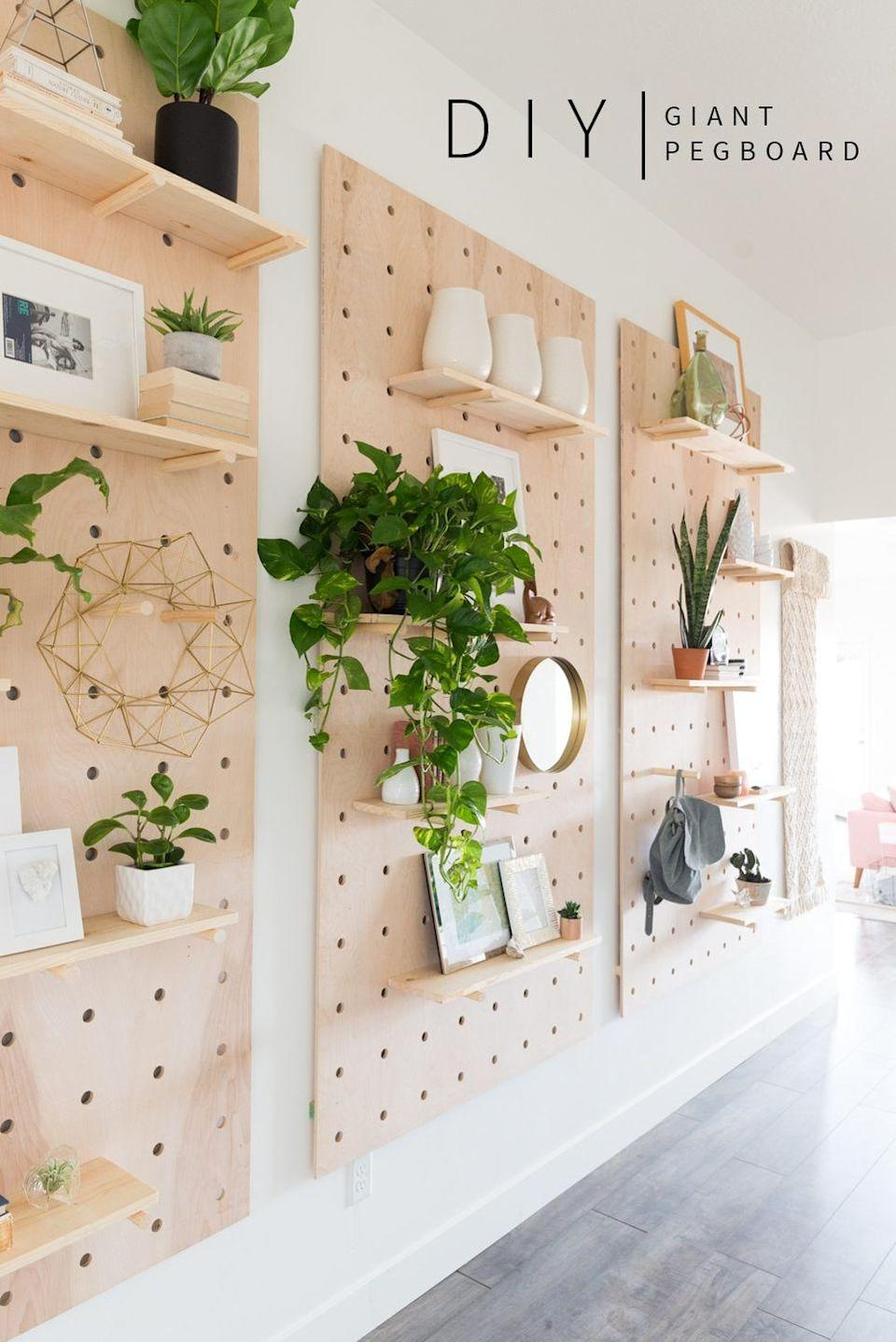 "<p>If add-on shelves feel too messy and cluttered for your walls, DIY pegboards. You'll gain additional space for vases, plants, mirrors, frames, etc., and warm up your space with the giant wooden wall covering.</p><p>Get the tutorial at <a href=""https://vintagerevivals.com/2017/01/giant-pegboard-diy"" rel=""nofollow noopener"" target=""_blank"" data-ylk=""slk:Vintage Revivals"" class=""link rapid-noclick-resp"">Vintage Revivals</a>.</p>"