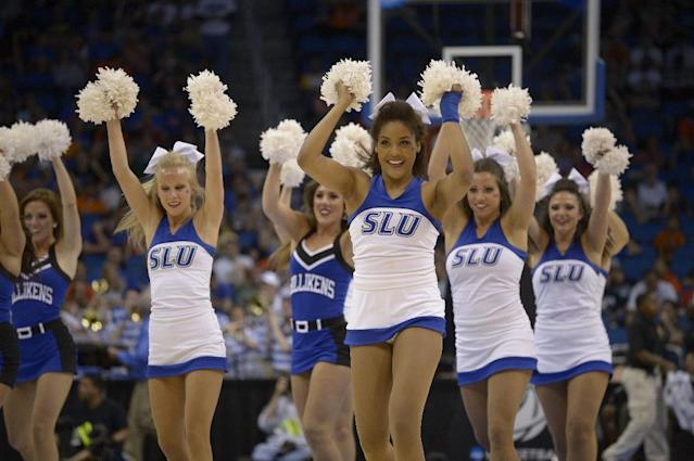 The Saint Louis dancers perform during the second half in a third-round game in the NCAA college basketball tournament against Louisville, Saturday, March 22, 2014, in Orlando, Fla. (AP Photo/Phelan M. Ebenhack)