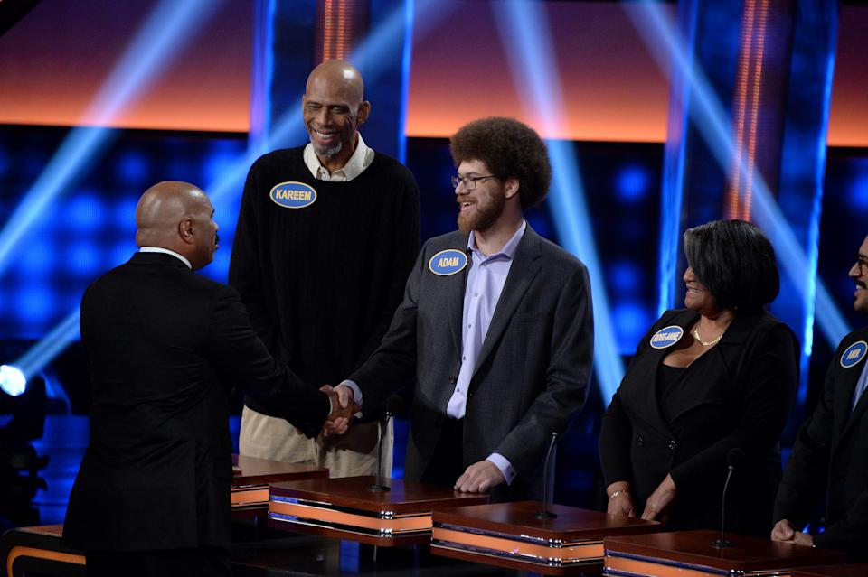 """CELEBRITY FAMILY FEUD - """"Harvey Family Men vs Harvey Family Women and Kareem Abdul-Jabbar vs Ralph Sampson""""- The celebrity teams competing to win cash for their charities features Steve Harvey's wife, Marjorie Harvey, leading a team with their sons and sons-in-law, and the other team will be led by Mrs. Harvey's mother and the Harvey daughters. In a separate game, family members from the NBA's all-time leading scorer and six-time NBA champion Kareem Abdul-Jabbar will take on retired NBA Legend Ralph Sampson and his family. This episode of """"Celebrity Family Feud"""" airs SUNDAY, JUNE 25 (8:00-9:00 p.m. EDT), on The Walt Disney Television via Getty Images Television Network.. (Eric McCandless/Walt Disney Television via Getty Images) STEVE HARVEY, KAREEM ABDUL-JABBAR, ADAM ABDUL-JABBAR, ROSE-ANN SWANN"""