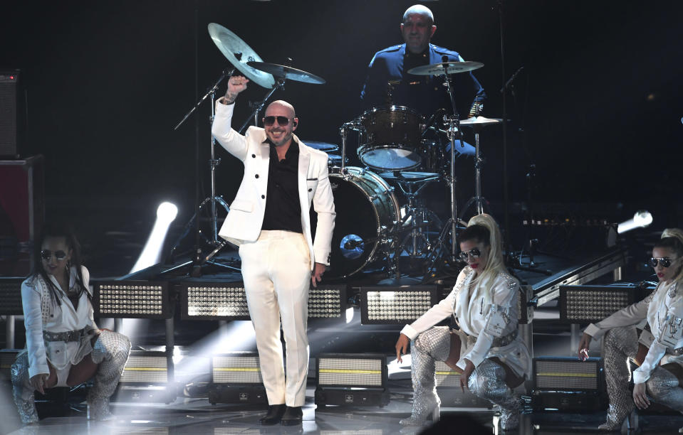 Pitbull performs along with frontline workers as his band for the 21st Latin Grammy Awards, airing on Thursday, Nov. 19, 2020, at American Airlines Arena in Miami. (AP Photo/Taimy Alvarez)