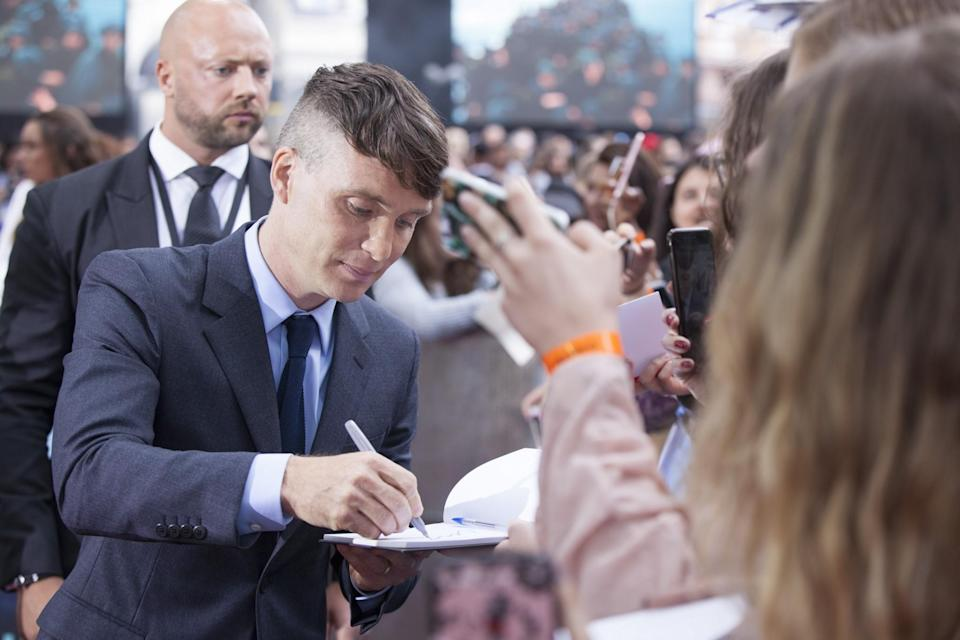 <p>'Peaky Blinders' star Cillian Murphy signing autographs (WB) </p>