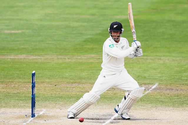 DUNEDIN, NEW ZEALAND - DECEMBER 07: Aaron Redmond of New Zealand cuts the ball away during day five of the first test match between New Zealand and the West Indies at University Oval on December 7, 2013 in Dunedin, New Zealand. (Photo by Hannah Johnston/Getty Images)