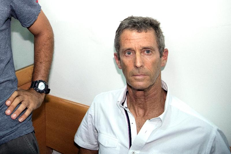 Israeli diamond magnate Beny Steinmetz arrives at a court in Rishon Lezion near Tel Aviv on August 14, 2017
