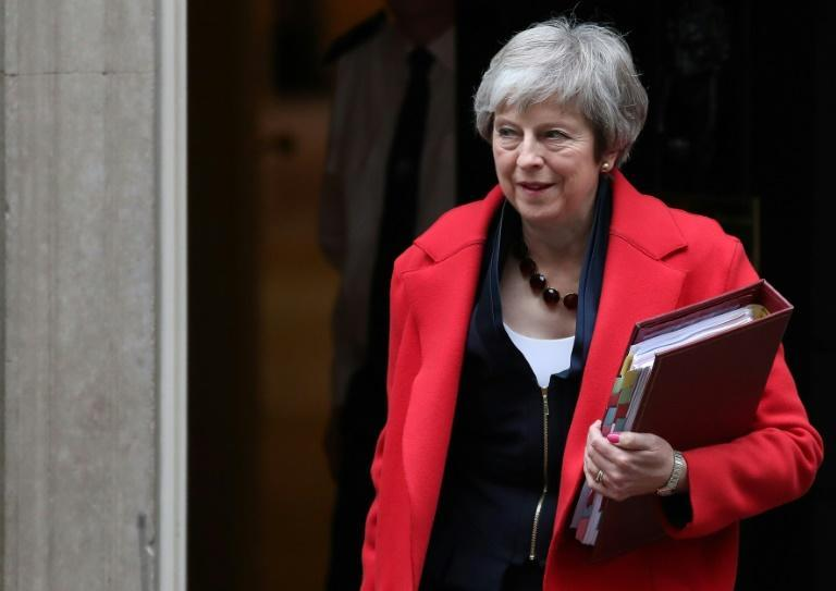 Britain's Prime Minister Theresa May leaves her 10 Downing Street office in London
