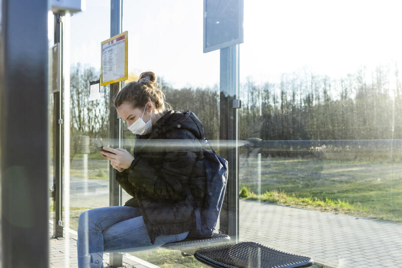 Having to sit outside to access WiFi is a challenge faced by many students who are returning to remote learning without access to a broadband signal. (Photo: Getty Images)