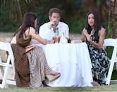<p>Harry introduced Meghan to all of his friends while attending the wedding of Tom Inskip and Lara Hughes-Young in Jamaica. The pair were spotted eating and drinking together with Meghan donning a gorgeous Erdem gown.<br><i>[Photo: FameFlynet]</i> </p>