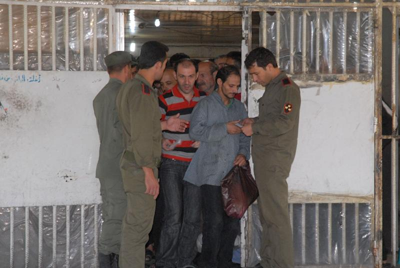 Inmates are released from the Damascus Central Prison in June 2014 after an amnesty was announced