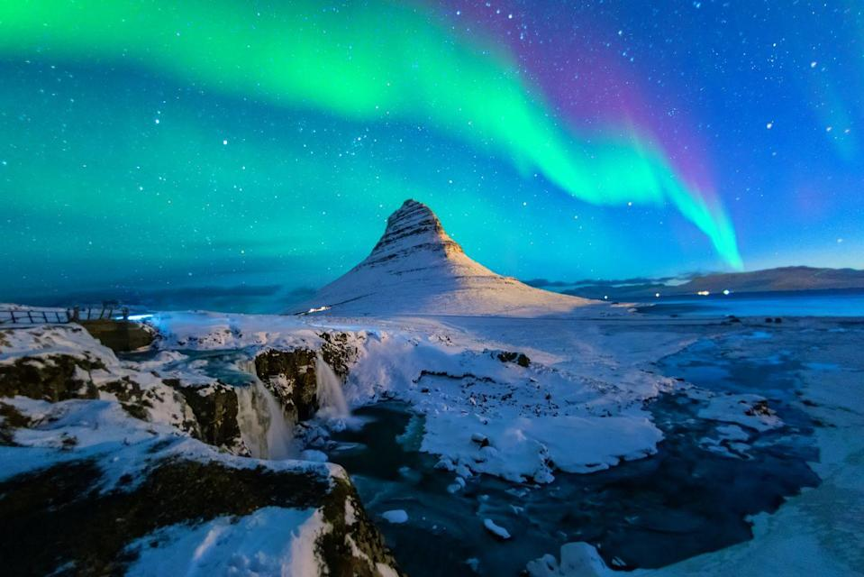 <p>The Northern Lights on display at Kirkjufell mountain.</p>