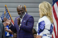 FILE - In this June 29, 2021, file photo former Dallas Cowboy and Football Hall of Famer Emmitt Smith applauds as first lady Jill Biden is introduced to speak at Emmett J. Conrad High School in Dallas. (AP Photo/Carolyn Kaster, Pool, File)