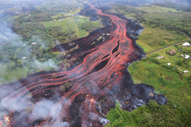 <p>In this Saturday, May 19, 2018, photo released by the U.S. Geological Survey, lava flows from fissures near Pahoa, Hawaii. (Photo: U.S. Geological Survey via AP) </p>
