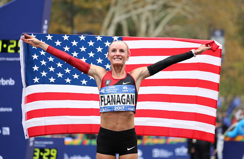 Shalane Flanagan celebrates her victory on Sunday in the New York City Marathon. (Elsa via Getty Images)