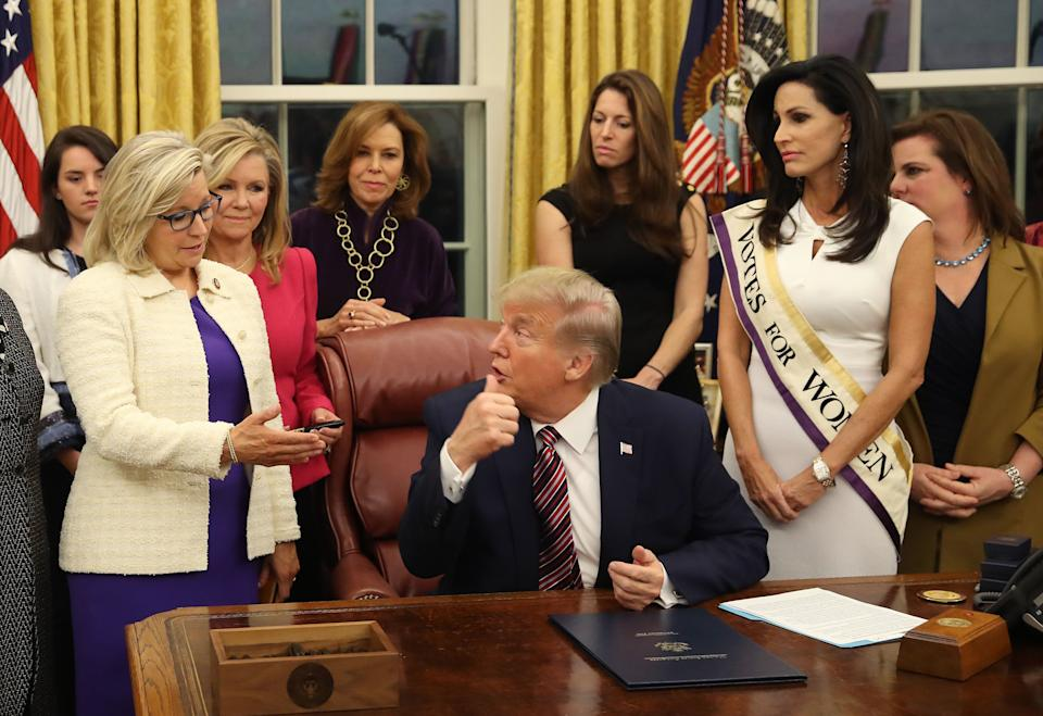 Then-President Donald Trump talks with Rep. Liz Cheney (left) after a bill-signing in the Oval Office at the White House in 2019. (Photo: Mark Wilson via Getty Images)