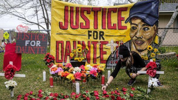 PHOTO: A person decorates a memorial for Daunte Wright with flowers and dandelions in Brooklyn Center, Minn., May 2, 2021. (Stephen Maturen/Getty Images)