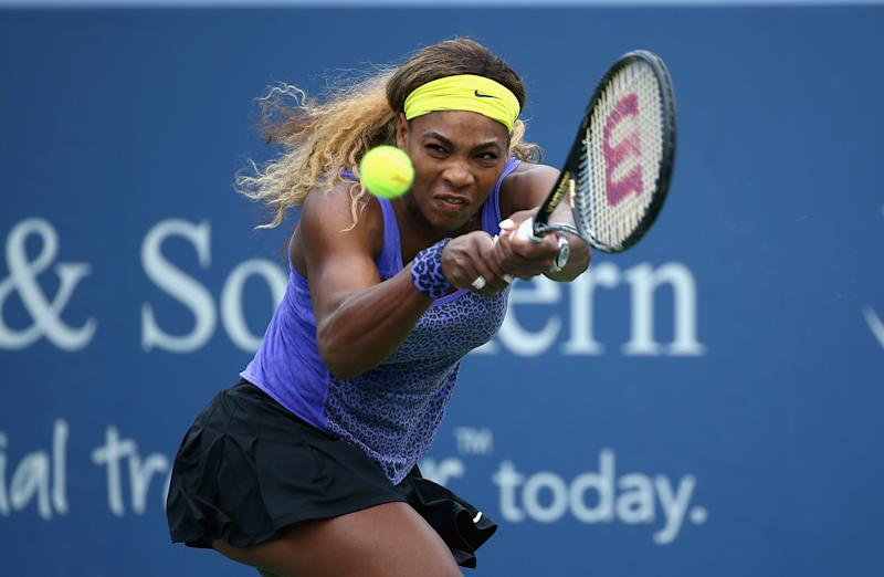 Serena Williams hits a return during her match against Caroline Wozniacki of Denmark on day 8 of the Western & Southern Open on August 16, 2014 at the Linder Family Tennis Center in Cincinnati, Ohio (AFP Photo/Andy Lyons)