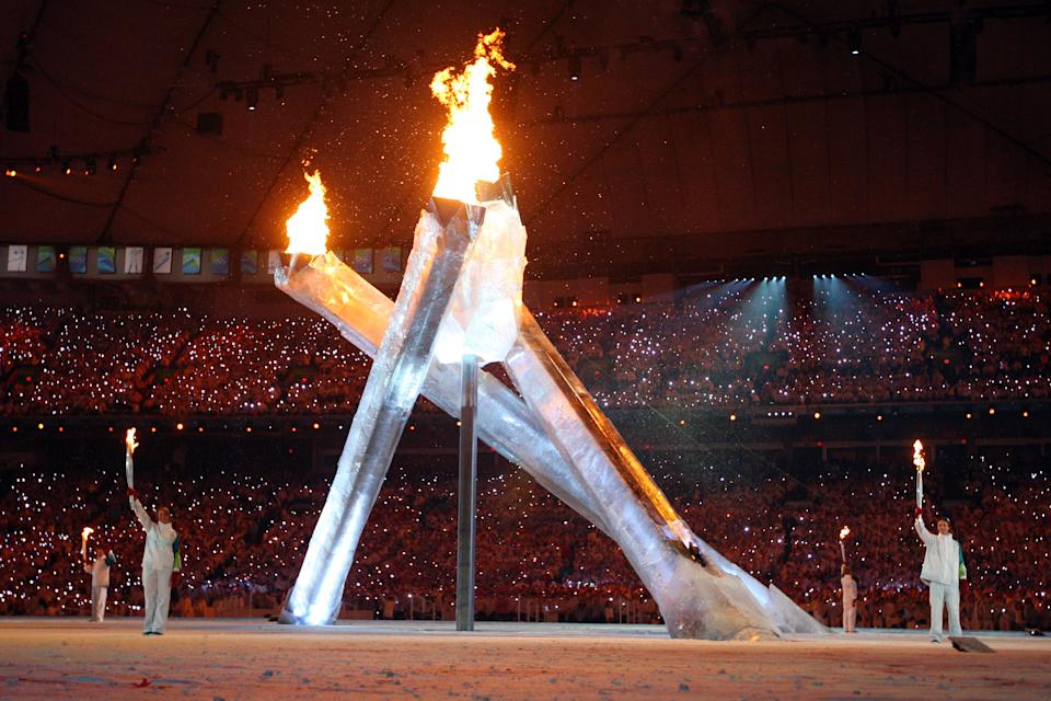 A lopsided Olympic flame was lit during the 2010 Vancouver Winter Olympics Opening Ceremony. An arm that was supposed to rise up a meet the other three malfunctioned, leaving one torchbearer with nothing to do. (Photo by Cameron Spencer/Getty Images)