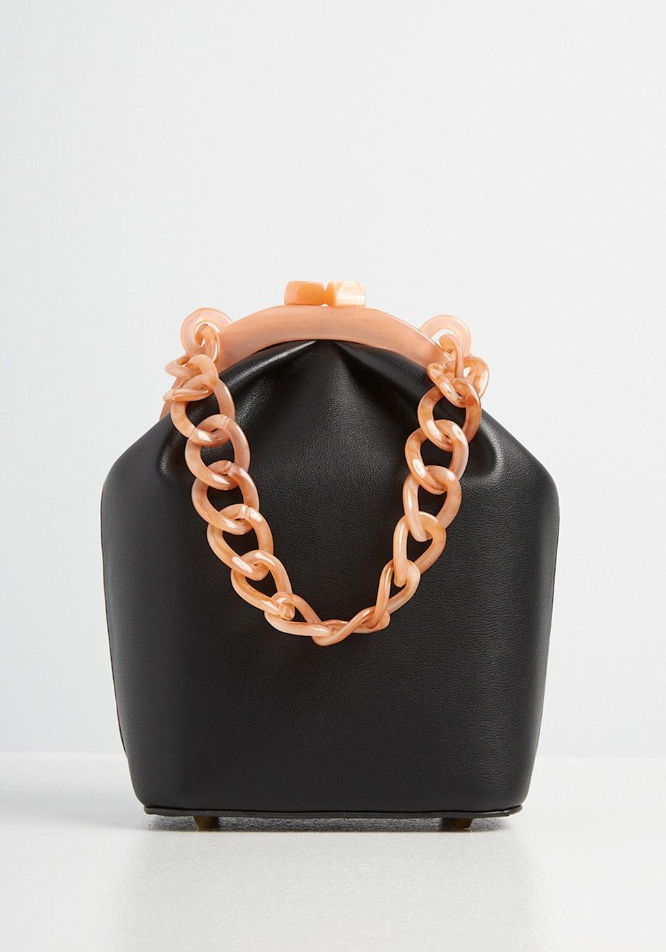 <p><span>ModCloth Lusting Over Leather and Lucite Bag</span> ($69)</p>