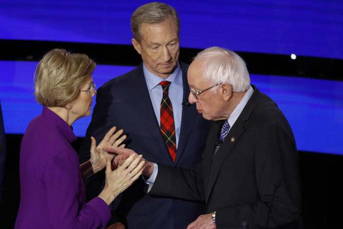 Elizabeth Warren and Bernie Sanders exchange words while Tom Steyer looks on after Tuesday's Democratic primary debate. (AP Photo/Patrick Semansky)