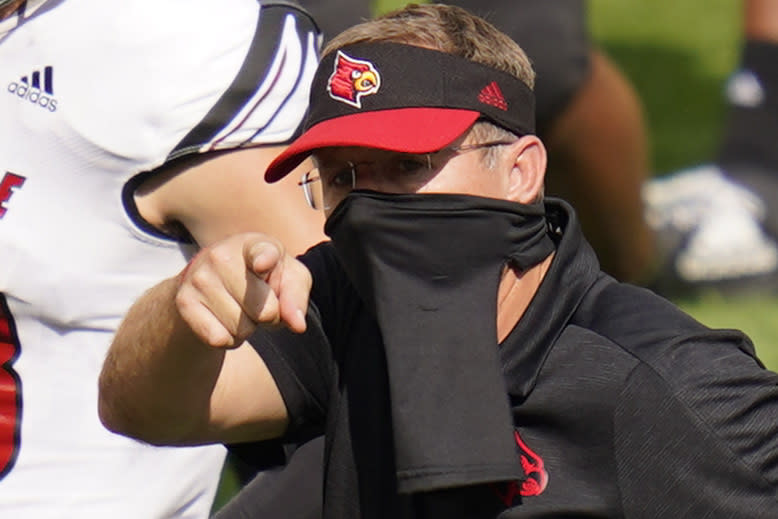 Louisville head coach Scott Satterfield points towards the Pittsburgh bench after an NCAA college football game, Saturday, Sept. 26, 2020, in Pittsburgh. (AP Photo/Keith Srakocic)