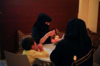 Women and a boy sit in the only all-female internet cafe in Marib