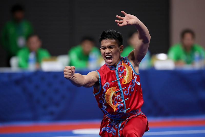 Mohammad Adi Salihin Roslan of Brunei Darussalam performs his routine during the Wushu Taoulu Men's Nanquan event for the 30th SEA Games held in Manila on December 3, 2019. (Photo by George Calvelo/NurPhoto via Getty Images)
